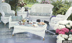 Country wicker rocker, coffee table, settee and end tables